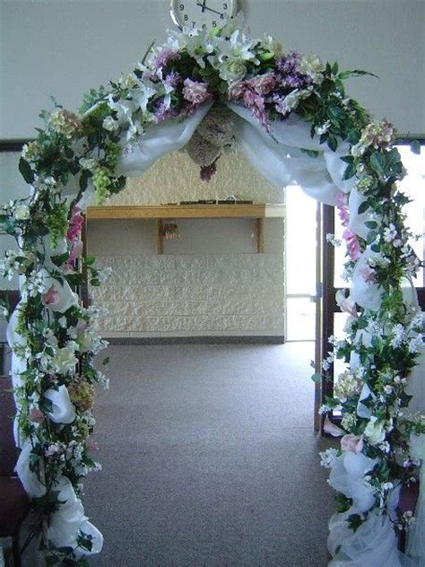 Wedding arch with hints of sage and lavender   Wedding