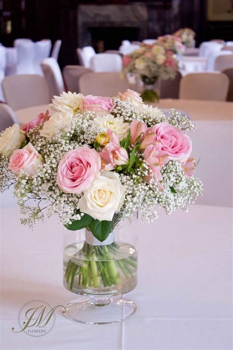 Wedding table arrangement, made of gypsophila, pink roses