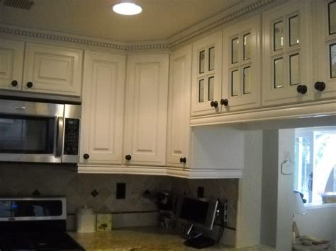white cabinets with crown molding white kitchen cabinet with dentil crown molding and 4 lite