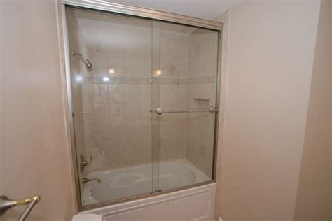 kohler bathtub shower doors kohler devonshire tub with recessed shoo shelf tall