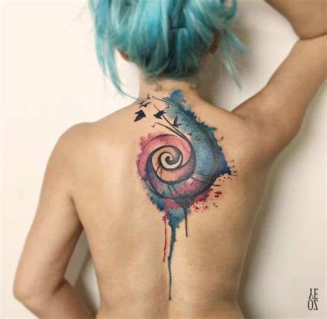 colorful spiral back piece with birds best tattoo design