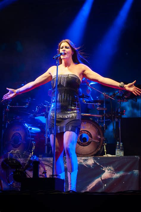 floor jansen floor jansen 6 1 of the finnish band nightwish standing