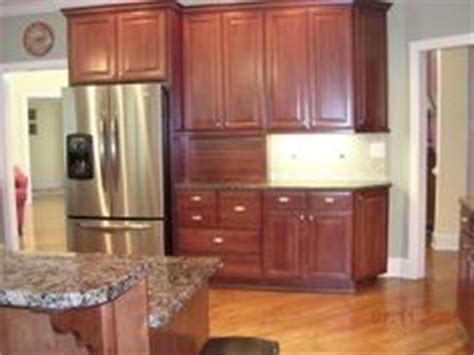 1000 images about hardware for cherry cabinets on cherry cabinets cherry kitchen