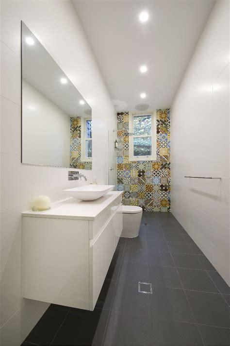 long narrow bathroom  tiled feature wall