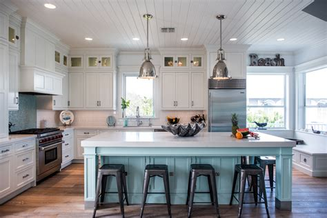 Intracoastal beach home with large kitchen island with open table end waterview kitchens