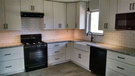 poll white cabinets black appliances granite and orb