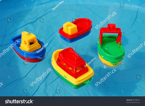 toy boat pic toy boats in a water pool stock photo 60788875 shutterstock