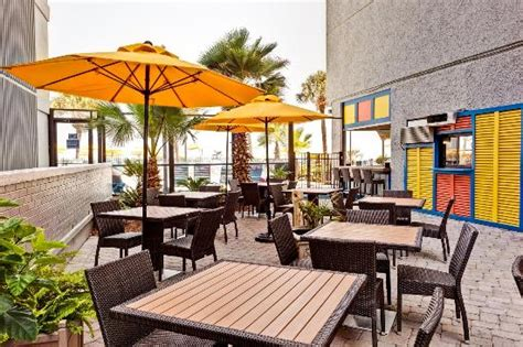 backyard bar and grill myrtle beach yella umbrella poolside bar and grill patio picture of