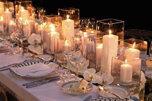 Centerpieces With Candles Romantic Centerpieces With Candle Filled Hurricane Vases Onewed Com