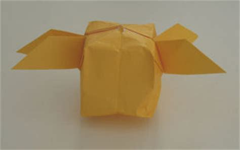 Origami Snitch - fashion and golden snitch craft and a snape r doll