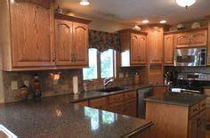 Honey Quartz 006 1000 images about black countertops w oak cabinets on