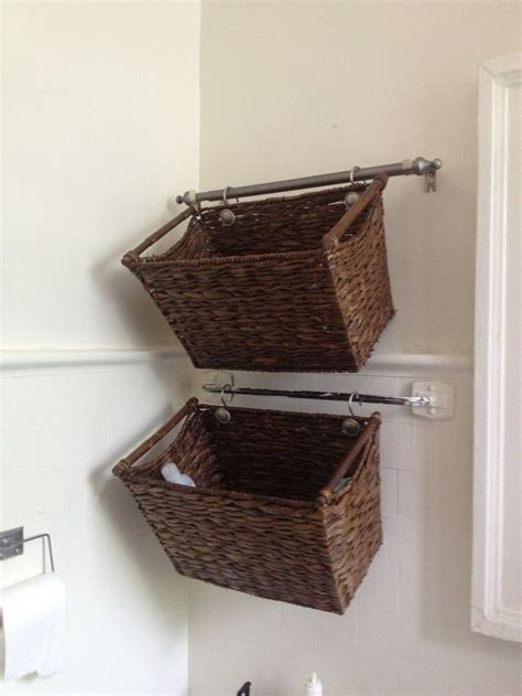 bathroom shelves with baskets cut down a curtain rod and hang wicker baskets for cute