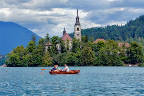 row boat to bled island assumption of mary pilgrimage church on lake bled island