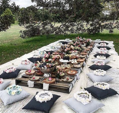 Boho outdoor tablescape with floor cushions   Tablescapes