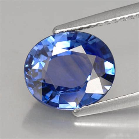 25 Ctrough Light Photo Blue Sapphire lab created synthetic light blue sapphire oval