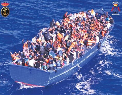 refugee boat italy spain spanish ship rescues over 500 refugees from fishing boat