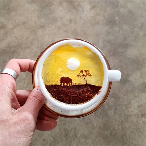 artistic coffee barista takes coffee to the next level with colored latte