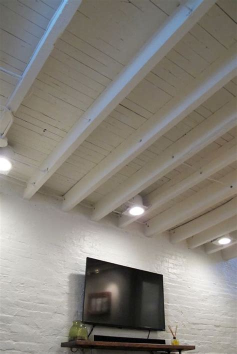 exposed ceiling joists cozy chic basement reno with exposed painted joists wood tile floors basements shallow and