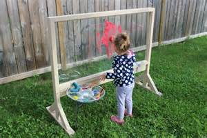 Kids Summer Arts And Crafts - inspiring creativity while painting on our plexiglass easel