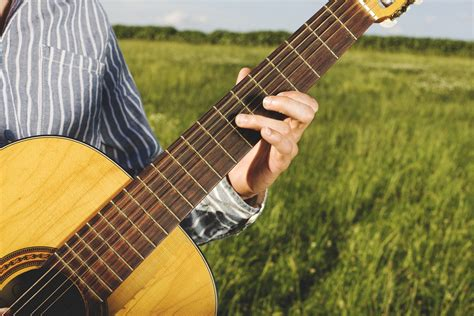 woman sitting holding guitar  stock photo