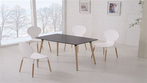 black dining table and 4 white chairs homegenies