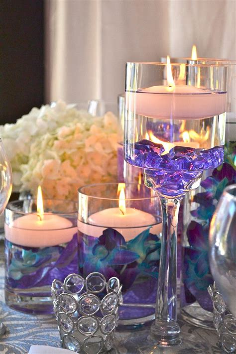 centerpieces ideas centerpieces floating canles and orchids reflects