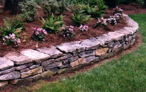flower bed stones low stone wall flower bed for the garden pinterest
