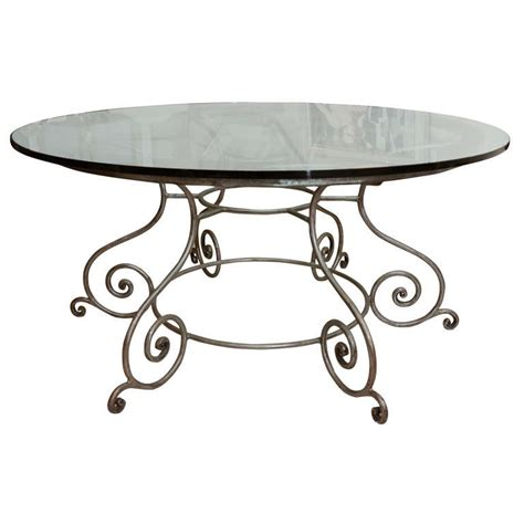 glass top dining table with attractive wrought iron