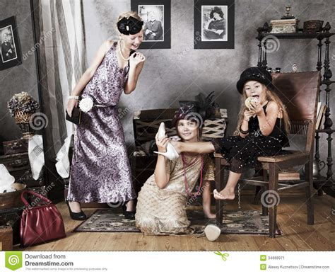old shoes on the floor vintage beauty fashion photos little girls with retro fashion accessories stock image