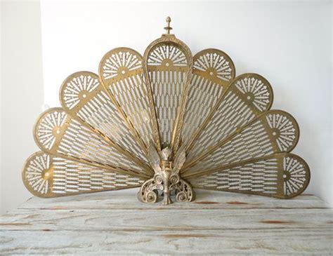 ornate brass peacock fireplace screen regency