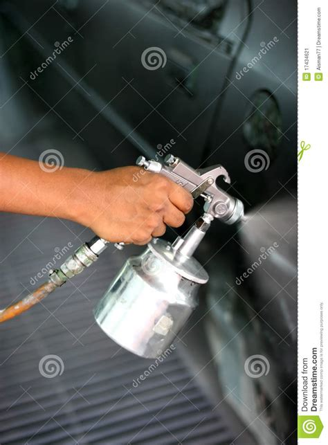 spray painting your gun with spray paint gun stock image image of background
