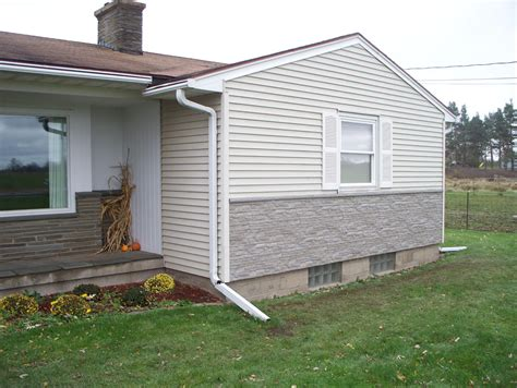 rock siding repair faux rock siding the wooden houses covering