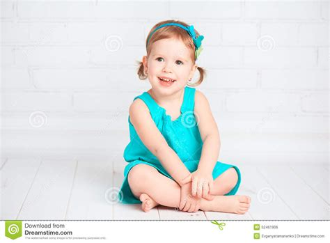 buying a house with a girlfriend beautiful little girl holding a toy model house buying a house concept royalty free