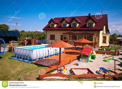 sand backyard backyard with swimming pool and sandbox stock photo image 43769848