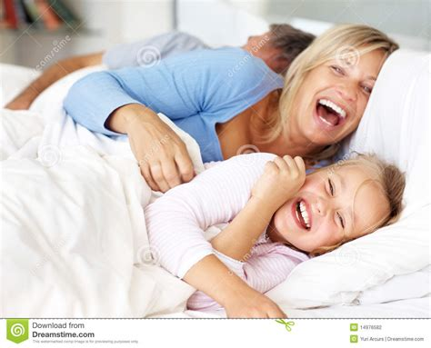 fun in bed happy family having fun in morning on bed stock photo