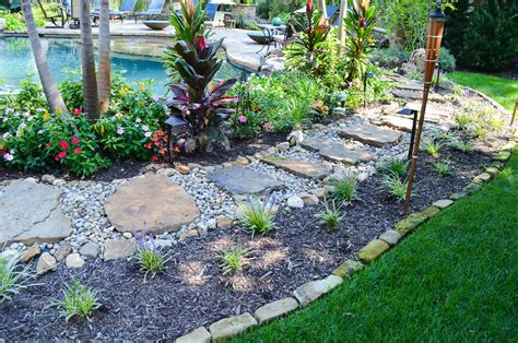 Landscape Rock Kansas City Mo Black Tumbled Edging Semco Outdoor Landscaping