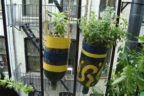 2 liter soda bottle planters hanging 2 liter bottle planters home and garden pinterest