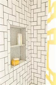 simple white subway tiles take on a whole new look when laid out in a geometric pattern with
