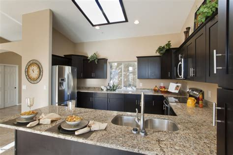 kitchen color schemes with black countertops distressed black kitchen cabinets capital granite cabinets flooring