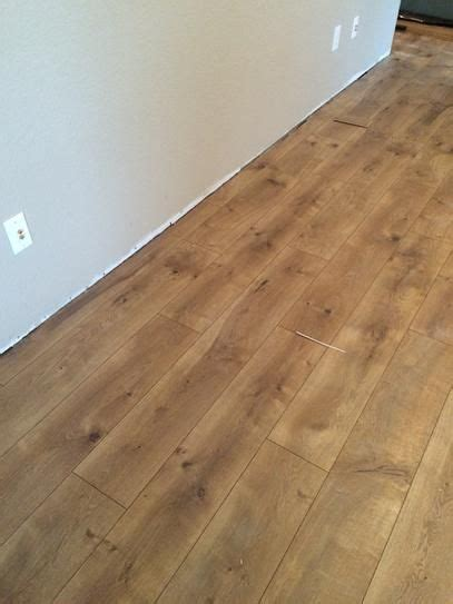 10 mm thick flooring pergo xp riverbend oak 10 mm thick x 7 1 2 in wide x 47 1