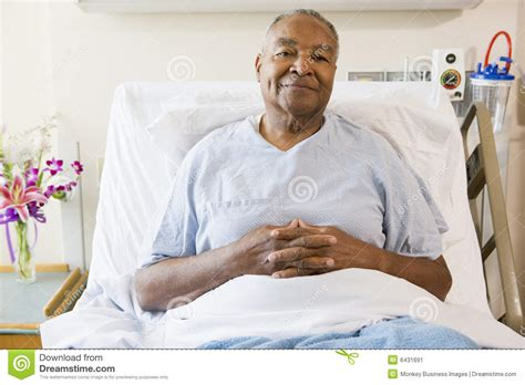 sitting in bed senior man sitting in hospital bed stock image image