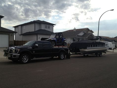Truck Boat Trailer by Truck Towing Boat Trailer And Hauling Side By Side