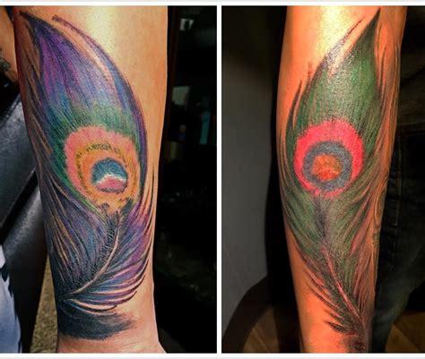 peacock feather tattoo hand 48 peacock tattoo design ideas design trends premium