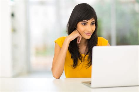 a woman looking at how to write subject lines that get your emails opened