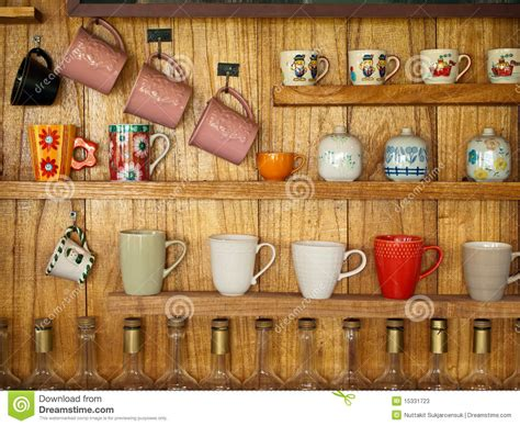 What Is The Shelf Of Coffee Beans by Coffee Cup On Wood Shelf Stock Photos Image 15331723