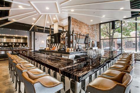 black restaurant zebrino black and gold bar at stirr restaurant by coeval