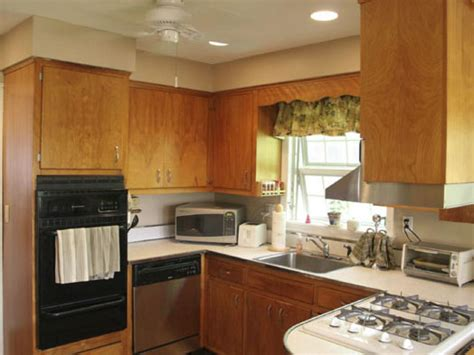 how to paint kitchen cabinets that are stained how to give your kitchen cabinets a makeover hgtv