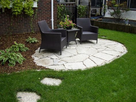 great backyard patio ideas with stone floor with black chair and coffee table green grass in
