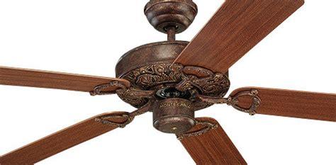 montecarlo ornate ceiling fan in tuscan bronze