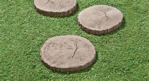 Use tree stump stepping stones to mark an informal path through a yard